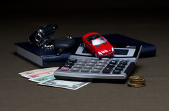 The Money with calculator and machine. The background.Money with calculator and machine on dark Stock Image