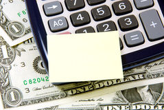 Money, calculator and note pad. Stock Images