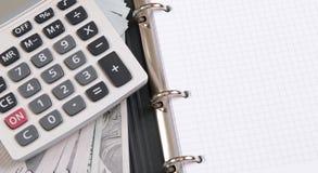 Money, calculator and notebook Stock Photo