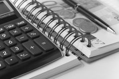 Money, calculator,notebook and  pen Stock Image