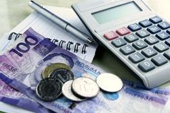 Money, calculator, notebook and pen Royalty Free Stock Photography