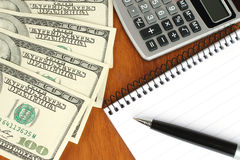Money, calculator, notepad and pen Royalty Free Stock Photos
