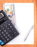 Money, calculator, notepad Stock Photos