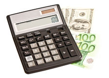 Money and calculator over white Royalty Free Stock Images