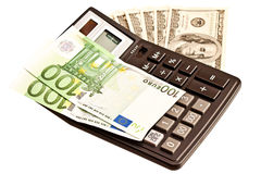 Money and calculator over white Stock Images