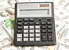 Money and calculator over white royalty free stock photography