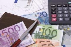 Money, calculator and pen Stock Photo