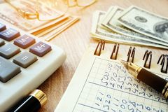 Money, calculator, pen and accounting book on desk. Money, calculator, pen and accounting book on a desk Stock Photography