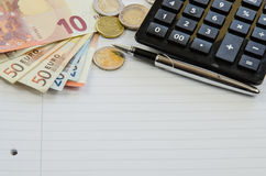 Money, calculator and pen Royalty Free Stock Photography