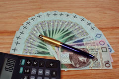 Money calculator pen Stock Image