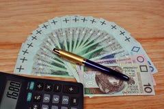 Money calculator pen Stock Image
