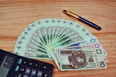 Money calculator pen Stock Photo
