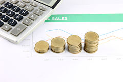 Money and Calculator placed on business Graphing. Stock Photo