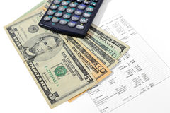 Money and calculator Stock Photos