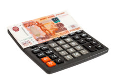 Money with calculator on a white background Royalty Free Stock Photo