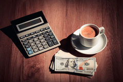 Money and calculator. On wooden background Royalty Free Stock Image