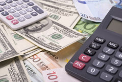 Money and calculators Stock Photography
