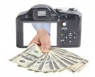 Money from camera. Conceptual photo for microstock photography, making money by camera shooting Stock Image
