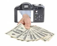 Money from camera. Conceptual photo for microstock photography, making money by camera shooting Royalty Free Stock Photography