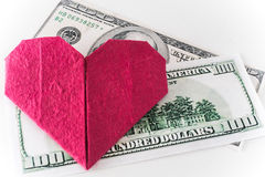 Money can buy love heart  and money. Money can buy love heart and money on white isolated background Royalty Free Stock Image