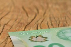 Money from Canada: Canadian Dollars. Close up of cash bills on rustic wood table. Concept of loan, wealth.n stock image