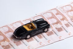 Money and car Royalty Free Stock Images