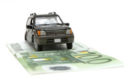 Money and car Royalty Free Stock Photos
