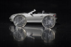 Money for Car. A car with an euro coin Royalty Free Stock Image