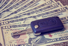 Money and car keys on a burlap background Royalty Free Stock Photography