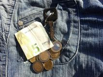 money with car keys and pocket Royalty Free Stock Photography