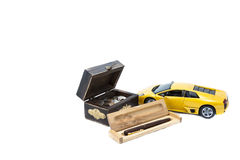 Money, car and pen. A treasure box with money, a car and a pen Royalty Free Stock Image