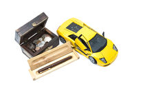 Money, car and pen. A treasure box with money, a car and a pen Royalty Free Stock Photos