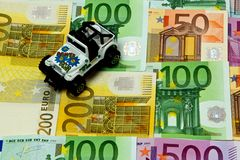 Money and a car Royalty Free Stock Photo