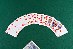 Money and cards. Playing cards - all hearts - and Chinese currency stock photo
