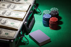 Money, cards and casino chips Stock Image