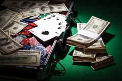 Money, cards and casino chips in suitcase Stock Image