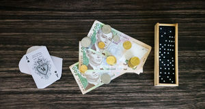 Money, cards and dominoes Royalty Free Stock Photos