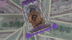 Money cart and money coins are spinning into it stock video footage