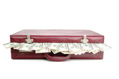 Money case. Suitcase with protruding american dollar banknotes isolated on white background Stock Images