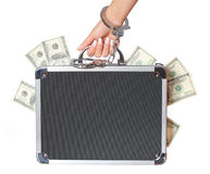 Money, case of dollars bills in female hand with handcuffs, isolated. On white. concert Royalty Free Stock Photo