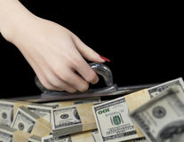 Money in case and woman hand business success concept Royalty Free Stock Photo