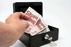 Money and cash  box. Money and cash box on white Royalty Free Stock Photography