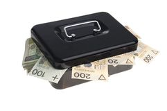 Money in cash box. Polish zlotys in black cash box isolated on white Stock Photos