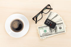 Money cash, glasses, car remote and coffee cup Stock Photo