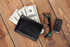 Money cash, glasses and car remote key Stock Photography