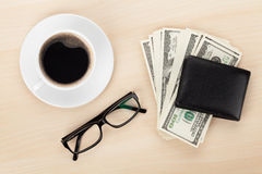 Money cash, glasses and coffee cup Royalty Free Stock Photos