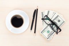 Money cash, glasses, pen and coffee cup royalty free stock image
