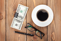 Money cash, glasses, pen and coffee cup Stock Photo