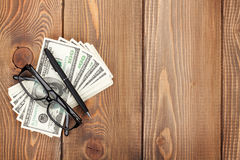 Money cash, glasses and pen Royalty Free Stock Photography