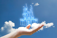 Money castle. Vivid line money castle on hand in the sky Royalty Free Stock Photography